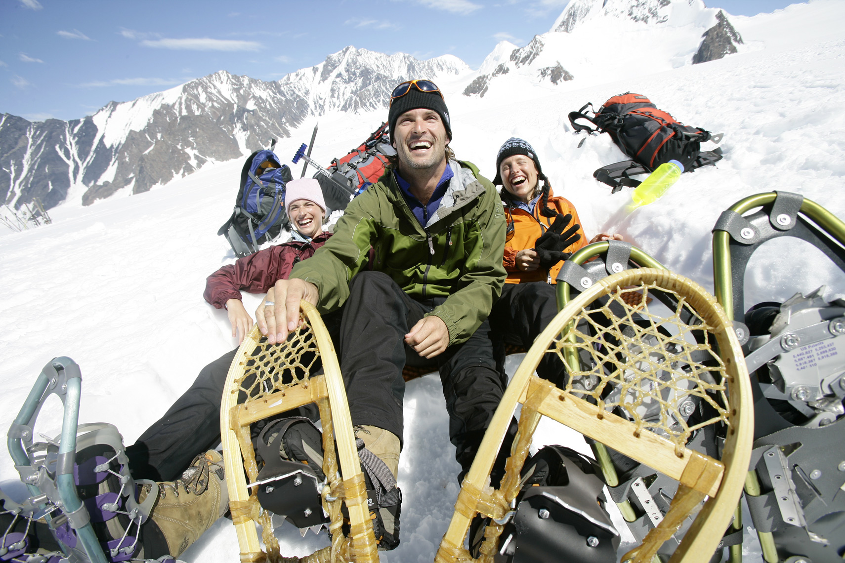 Several snowshoers enjoy a break in Alaska