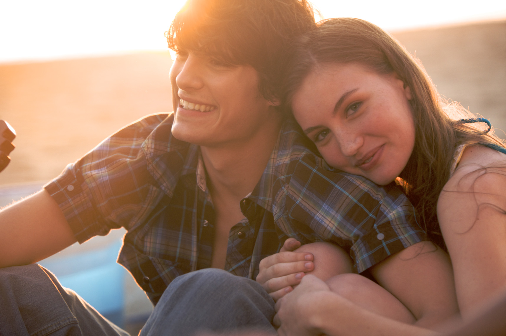 Young Couple enjoy,the beach,the sunset and each other/Steve Mason Photography