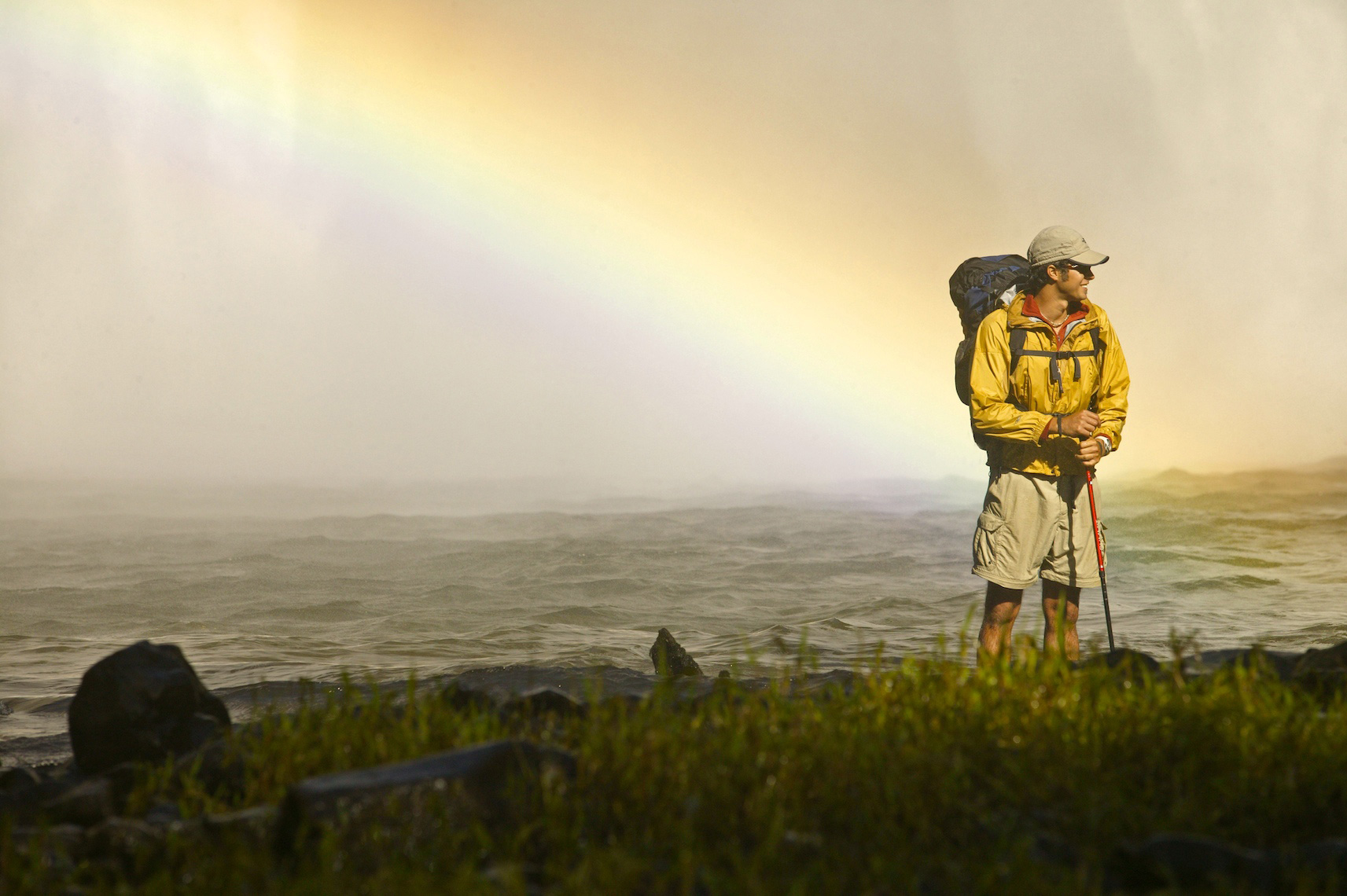 Rainbow over waterfall with Hiker in Hawaii/Steve Mason Photography